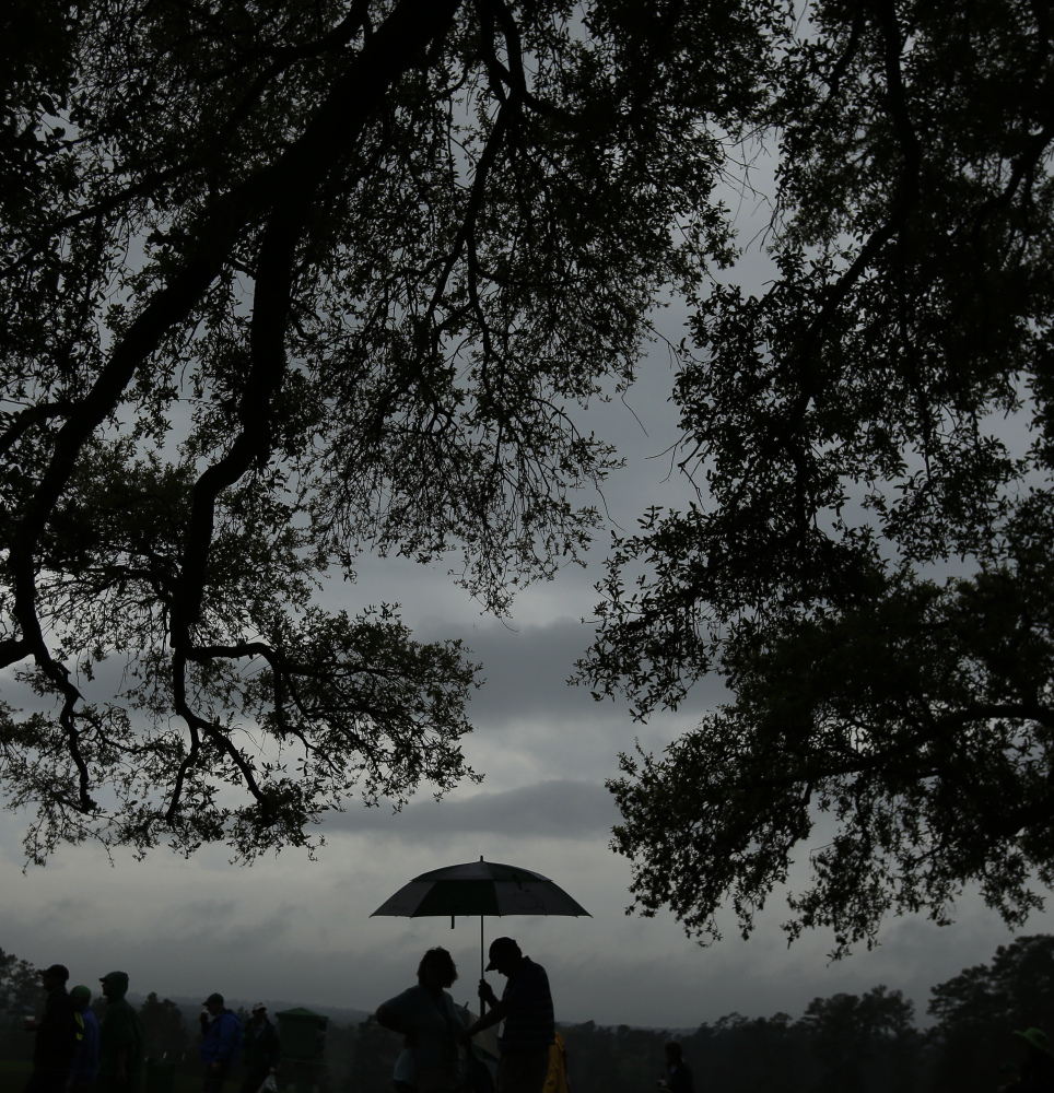 Wednesday was a day for huddling under an umbrella at Augusta National as fans braved the elements to check out the fun at the Par 3 competition. The serious stuff starts Thursday with the opening round of the Masters.