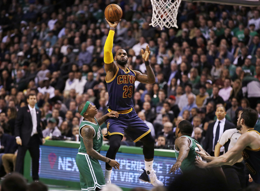 Cleveland's LeBron James shoots over Boston's Isaiah Thomas in the second quarter Wednesday night in Boston.
