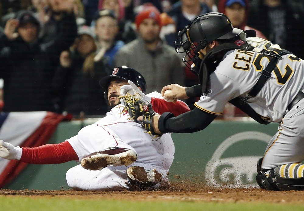 Boston's Sandy Leon, left, is tagged out at home by Pirates catcher Francisco Cervelli on a single by Dustin Pedroia in the third inning of a Wednesday night's game at Boston.