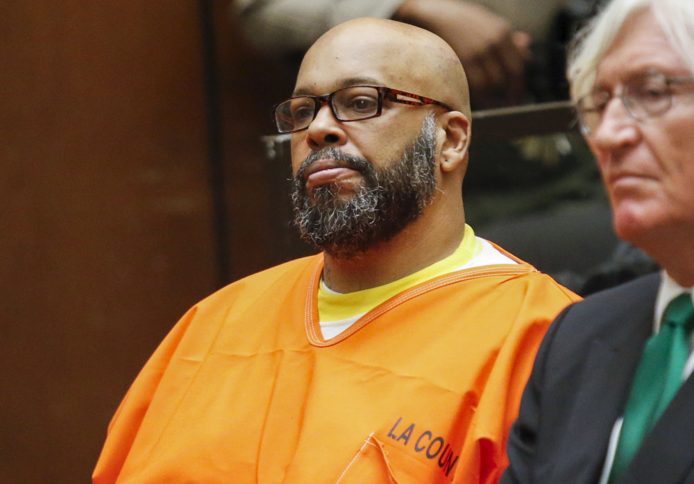 "Defendant Marion ""Suge"" Knight attends a hearing with attorney Thomas Mesereau in his murder case in Los Angele in 2015."