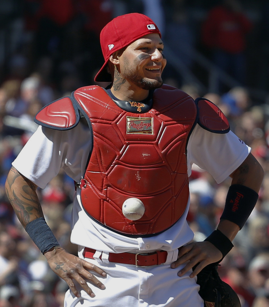 St. Louis catcher Yadier Molina couldn't find the ball after a pitch in the dirt Thursday, and no wonder. It was stuck to his chest protector. The batter reached on the third strike, leading to a Cubs comeback for a 6-4 victory.