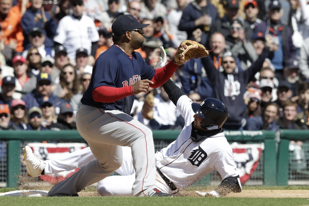 Detroit's Nicholas Castellanos slides into third as Red Sox third baseman Pablo Sandoval waits on the throw during the sixth inning Friday in Detroit.
