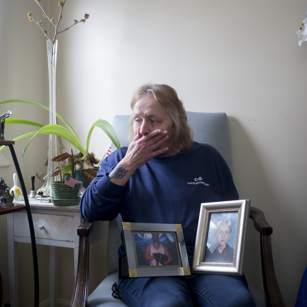 "Judy McEwen cries as she poses for a portrait with photos of her son, Mark Shackelford, who died from a drug overdose in November 2016. ""(Mark) was more than a drug addict and a statistic. He was a loving, caring man, with dreams and hope for a great life,"" his mom said."