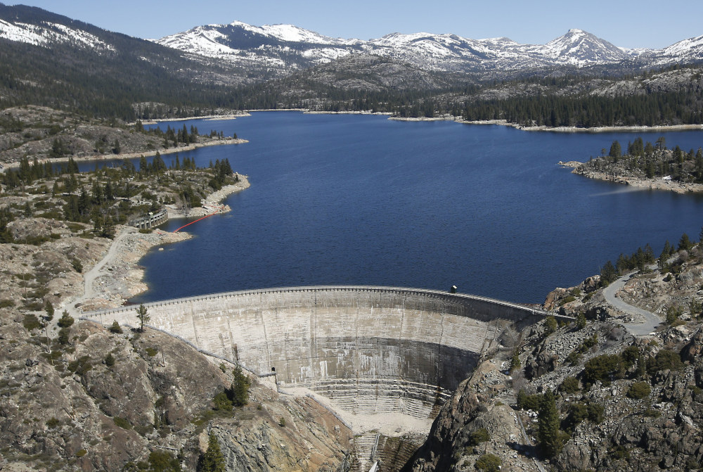 Deep, springtime snow covers the Sierra Nevada Mountains, providing much needed water for the hydroelectric dam at Lake Spaulding in California.