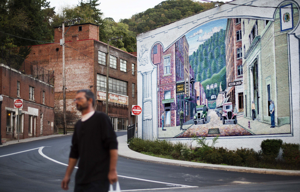A mural depictis a more vibrant time in Welch, W.Va. As coal has declined, people have fled and desperation has taken hold. Many residents turned to drugs to cope.