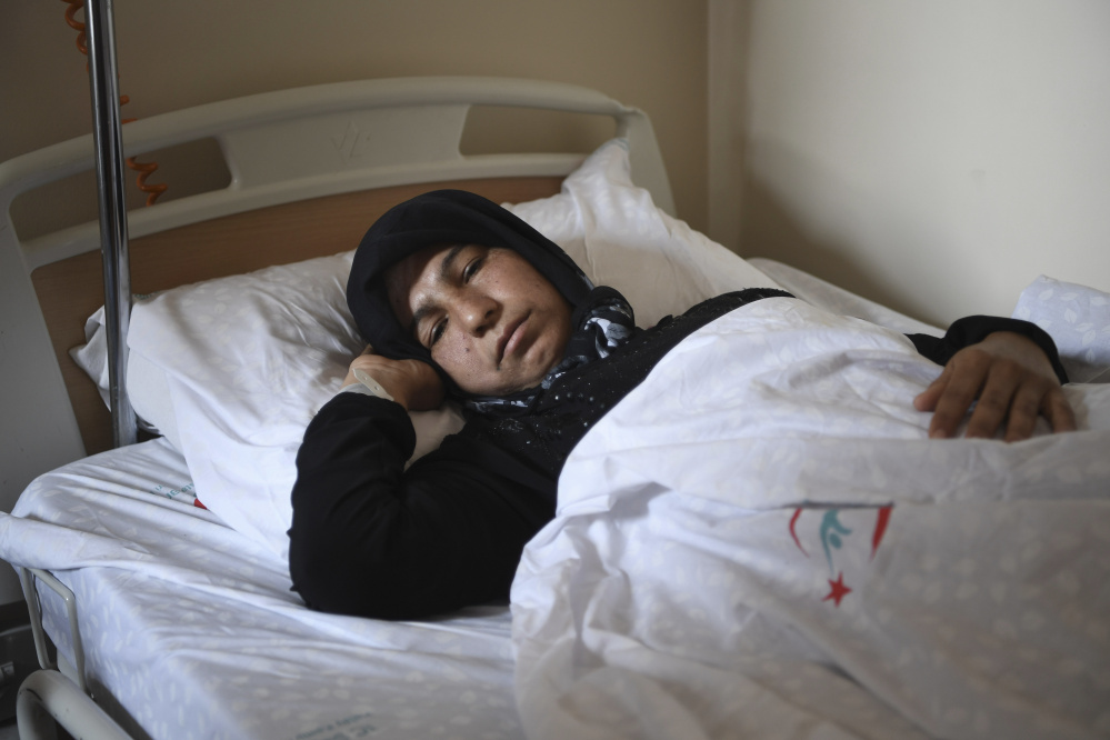 A Syrian woman rests in a hospital in Reyhanli, Turkey, on Friday. Turkish media, quoting Turkey's Justice Minister Bekir Bozdag and other officials, say autopsy results show Syrians were subjected to a chemical weapons attack in Idlib, Syria, on Tuesday. Associated Press photo