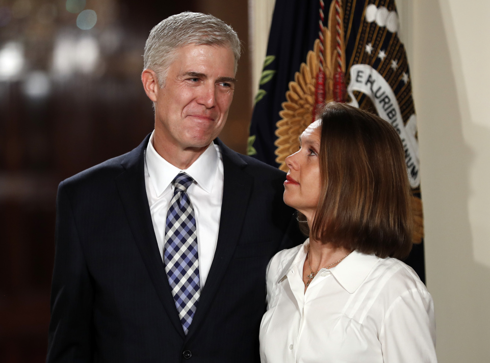Critics wonder whether there is an independent streak inside new Justice Neil Gorsuch, seen here with his wife, Marie Louise, when President Trump announced his appointment.