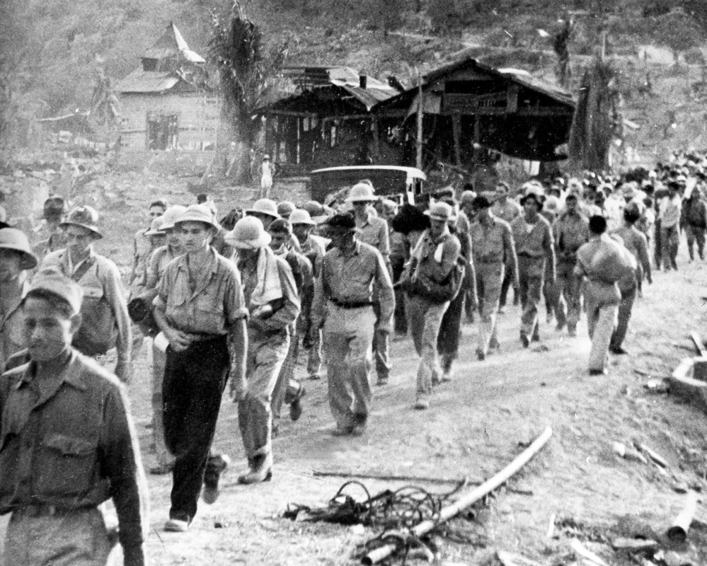 American and Filipino prisoners of war captured by the Japanese are shown at the start of the Death March after the surrender of Bataan in the Philippines during World War II.