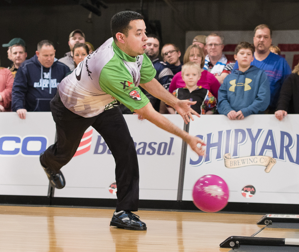 PBA Dallas Striker Team member Shawn Maldonado employs his unique two-handed bowling technique during last year's Elias Cup at Bayside Bowl in Portland. The tournament is returning for a third straight year. File photoe by Carl D. Walsh/Staff Photographer