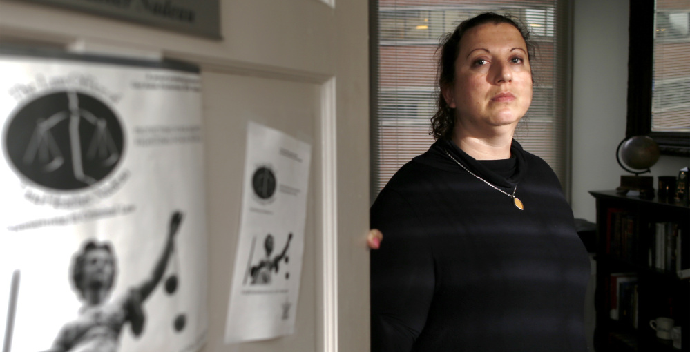 Though Abdi Ali appears to have a long criminal history, it's unclear what triggered immigration agents to detain him Thursday, when lawyer Tina Nadeau, above, was advising him at the Portland courthouse.