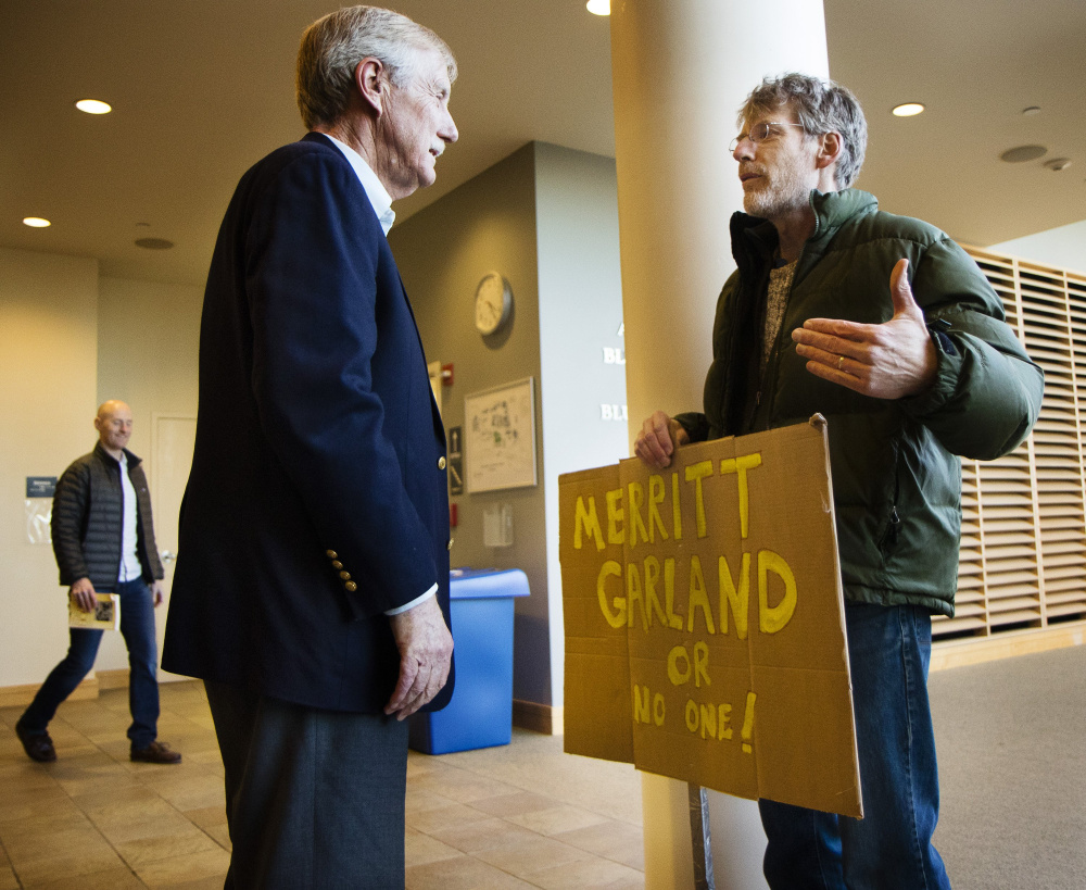 Sen. Angus King of Maine talks with David Simpson of Peaks Island before a March 5 town hall meeting on Neil Gorsuch's nomination to the U.S. Supreme Court. King's independent status was nowhere to be seen when he followed Democrats in opposing the court nominee, a reader says.