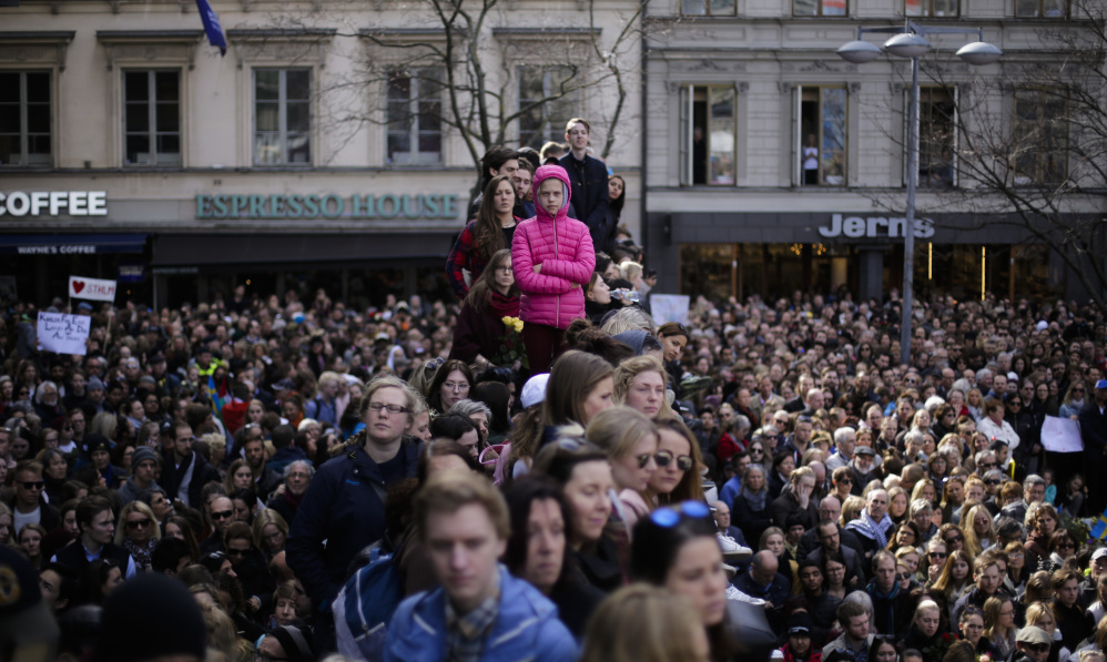 "Thousands of people attend a ""Lovefest"" vigil against terrorism in Sergels Torg, central Stockholm, on Sunday. A hijacked truck was driven into a crowd of pedestrians and crashed into a department store Friday in the Swedish capital."