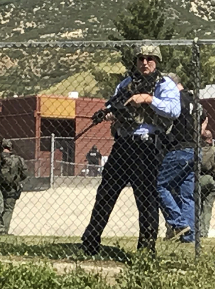 Emergency personnel respond to a fatal shooting inside North Park School in San Bernardino, Calif., on Monday.