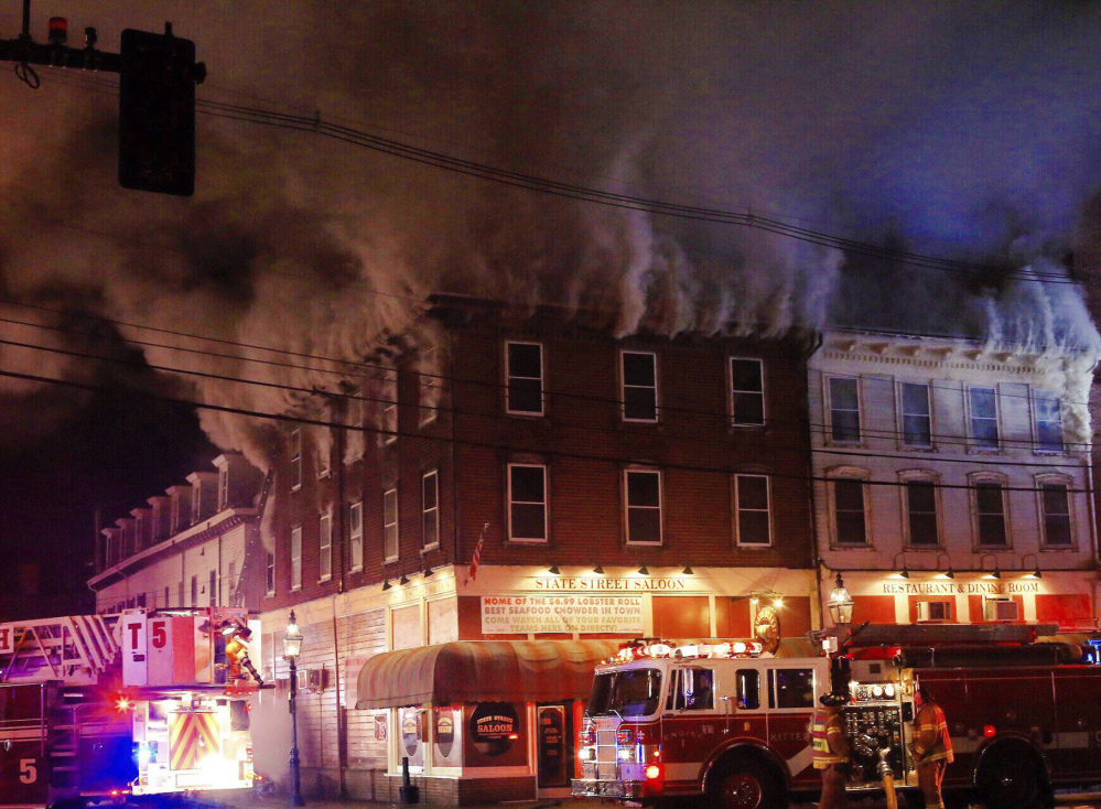 Authorities think a blaze that began about 12:30 a.m. Monday began in the kitchen of the State Street Saloon. The building is near Portsmouth's popular Market Square.