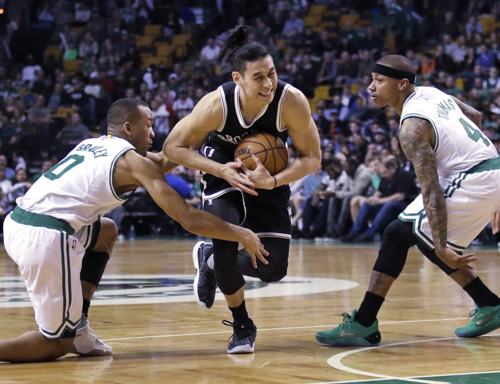 Brooklyn's Jeremy Lin drives between Avery Bradley, left, and Isaiah Thomas of the Celtics during Monday's game at TD Garden. Lin scored 26 points, but Boston won, 114-105. Associated Press/Charles Krupa