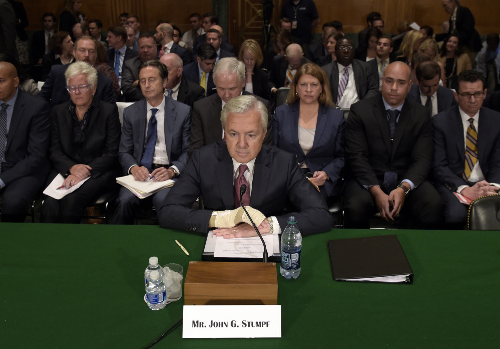 Wells Fargo's then-CEO John Stumpf testifies before the Senate Banking Committee last September about fake accounts created by bank employees to meet sales goals. Stumpf was an optimist