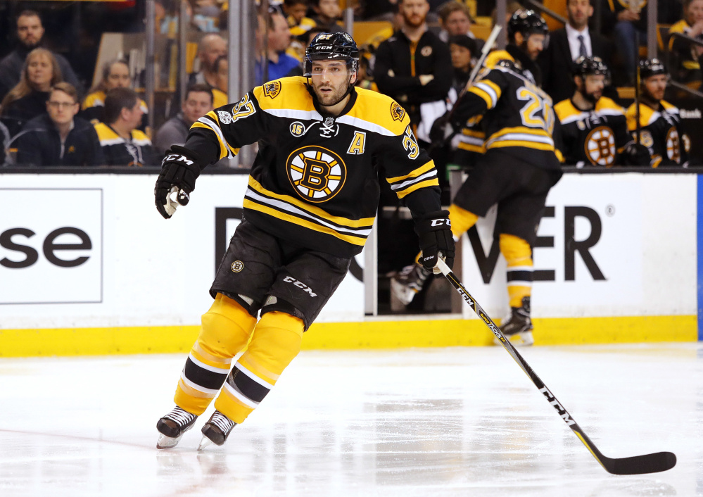 The Bruins' Patrice Bergeron skates in the second period of Saturday's game against the Washington Capitals in Boston – a loss to finish the regular season.