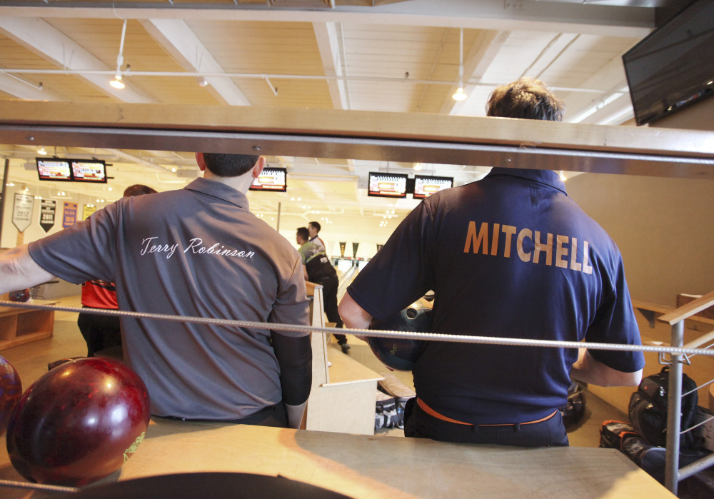 Terry Robinson and Charlie Mitchell watch the bowlers while awaiting their turns in the doubles tournament. Mitchell is a co-owner of the host Bayside Bowl.