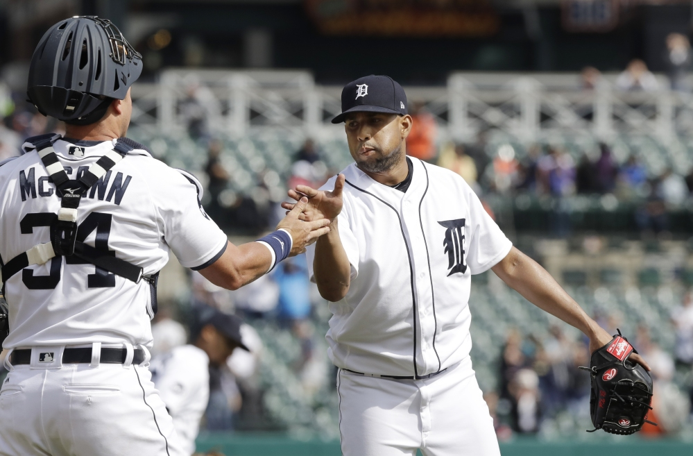 Francisco Rodriguez celebrates with catcher James McCann after closing out the Tigers' 2-1 win Monday over the Minnesota Twins. McCann drove in both Tiger runs with his third homer of the season.