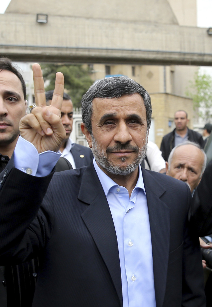 Former Iranian President Mahmoud Ahmadinejad,  flashes a victory sign in Tehran, Iran, on Wednesday.