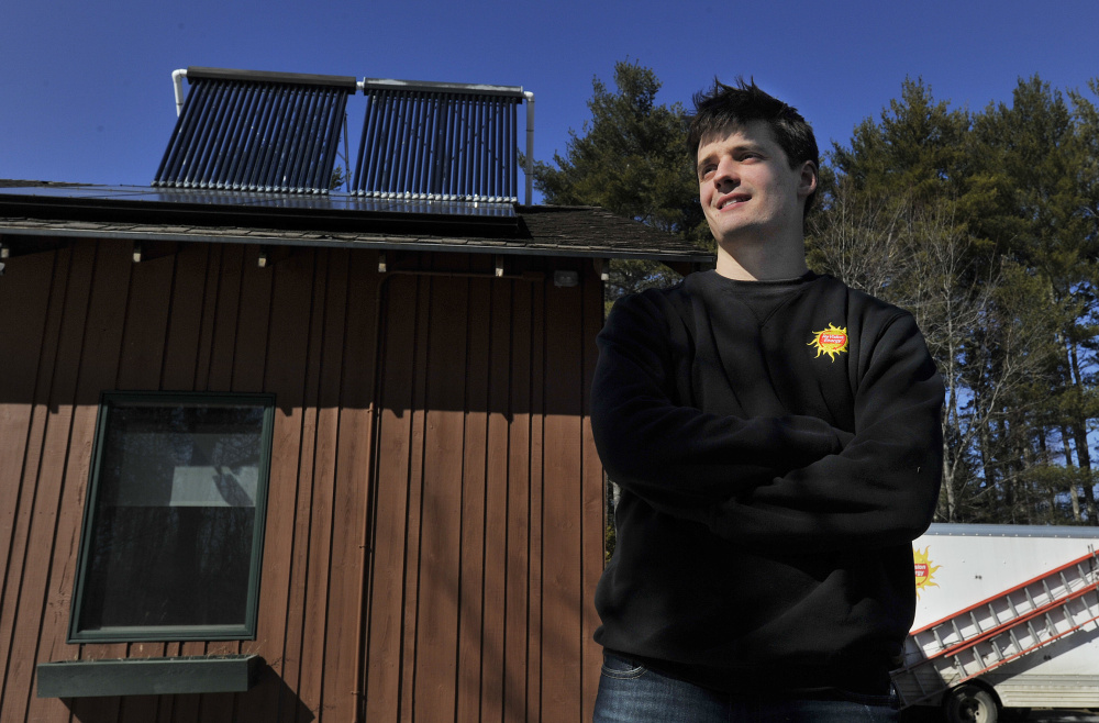 Clark Crawford, who graduated with a degree in sustainability from Unity College, now works for ReVision Energy in Liberty.