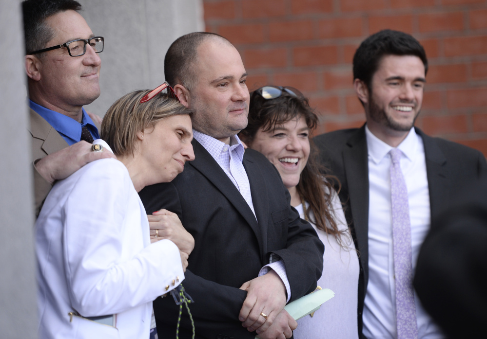 Anthony Sanborn Jr. appears after his release April 13 with his wife, Michelle, at left, and his attorney, Amy Fairfield, at right.