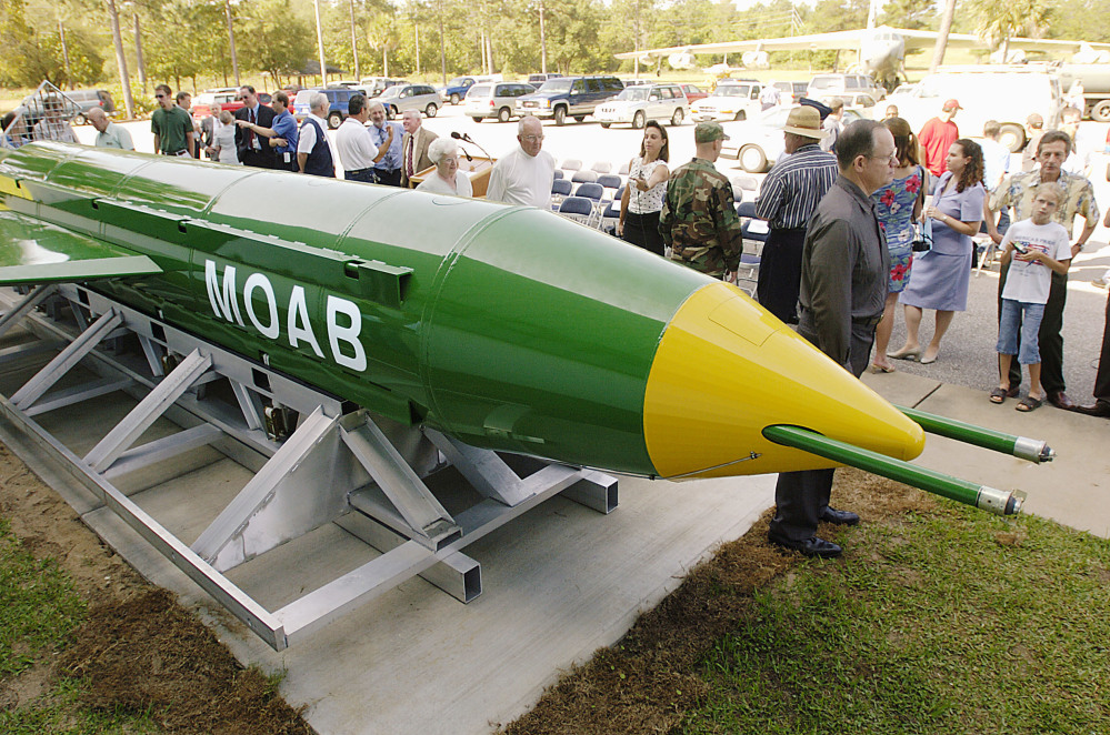 In this May 2004 photo, a group gathers around a GBU-43B, or massive ordnance air blast, bomb at the Air Force Armament Museum on Eglin Air Force Base near Valparaiso, Florida. U.S. forces in Afghanistan struck an Islamic State tunnel complex in eastern Afghanistan with the bomb on Thursday.