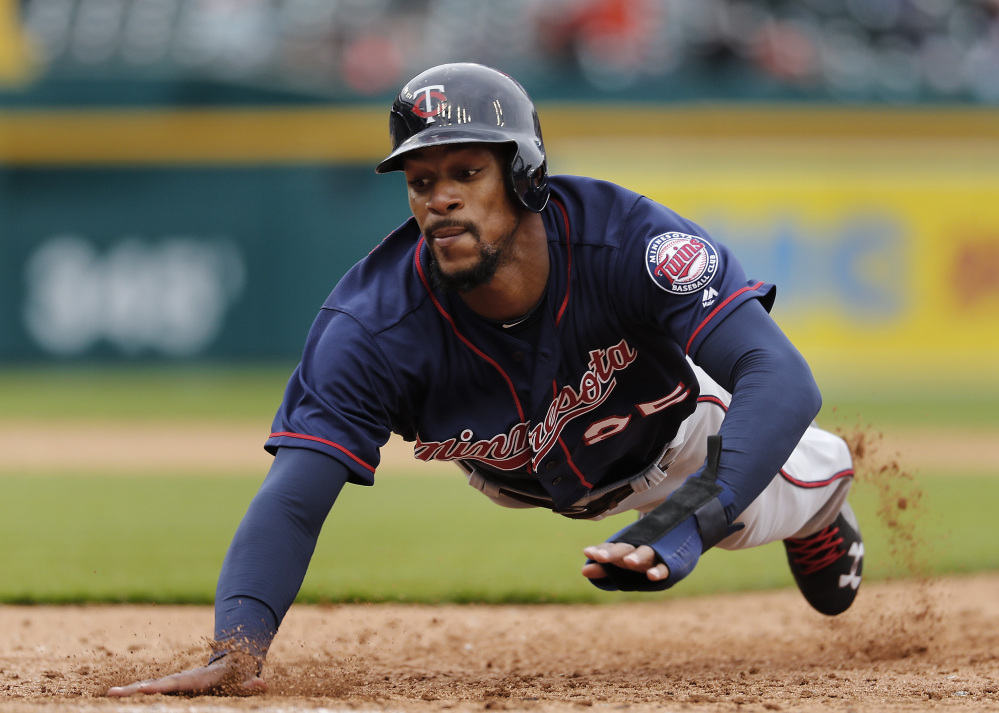 Byron Buxton of the Minnesota Twins dives safely back to first base on an attempted pickoff Thursday during the sixth inning of the 11-5 victory against the Detroit Tigers.