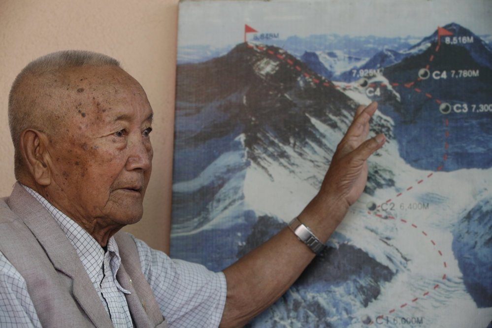 Nepalese climber Min Bahadur Sherchan points to the trail to Mount Everest in this recent photo taken in Kathmandu, Nepal.