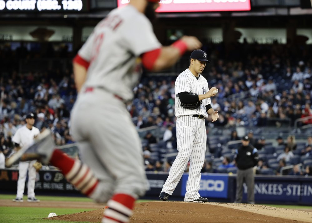 Masahiro Tanaka of the New York Yankees allowed a two-run homer to Matt Carpenter in the first inning Friday night, but recovered to lead the Yanks to a 4-3 victory at home.