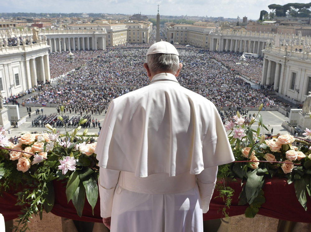 Pope Francis addresses a crowd of 60,000 before delivering his Urbi et Orbi (to the city and to the world) message from St. Peter's Basilica at the Vatican on Sunday.