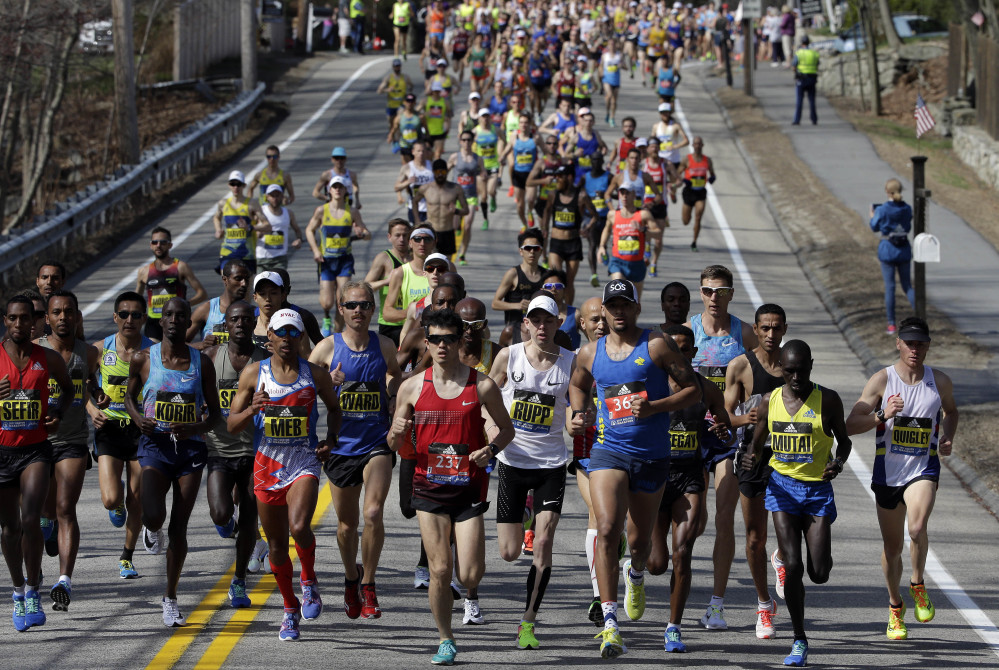 The elite men run at the front of the field along the course of the 121st Boston Marathon on Monday. Of the 193 Maine runners who started, 10 broke three hoursthe race in Hopkinton.