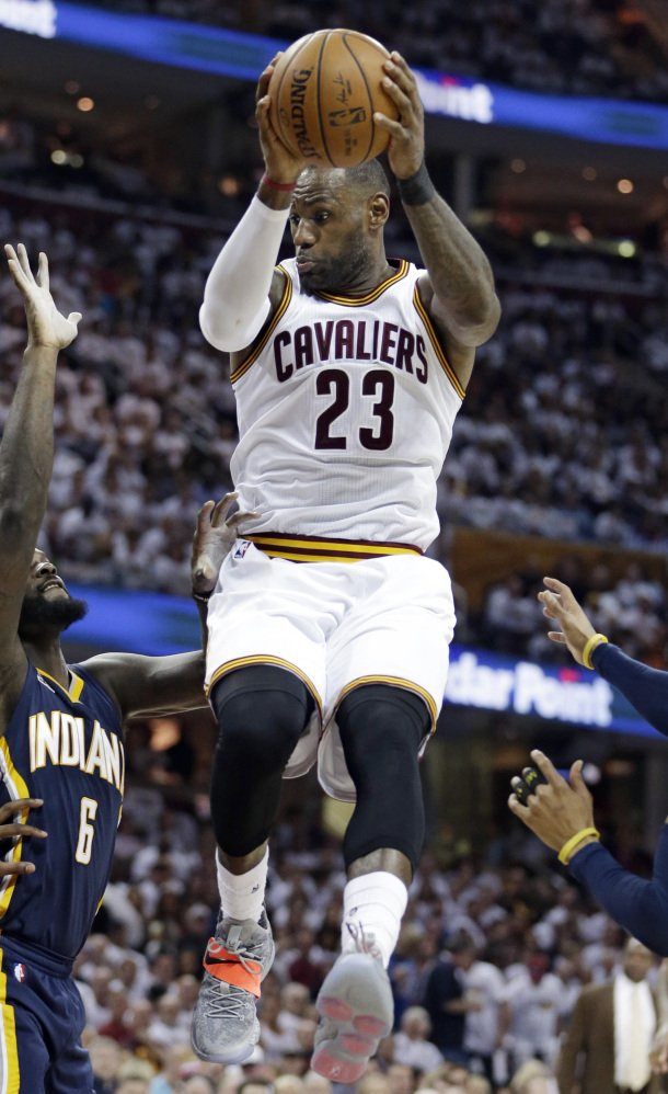 Cavaliers' LeBron James scored 25 points and grabbed 10 rebounds to help Cleveland beat Indiana 117-111 Monday in Cleveland.