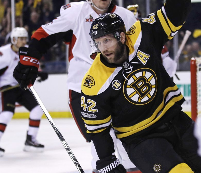 Boston center David Backes (42) celebrates after scoring on Ottawa goalie Craig Anderson (41) in the second period.