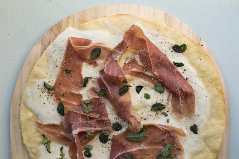 This pizza doesn't call for tomato sauce, allowing the burrata and cured ham flavors to come forth.