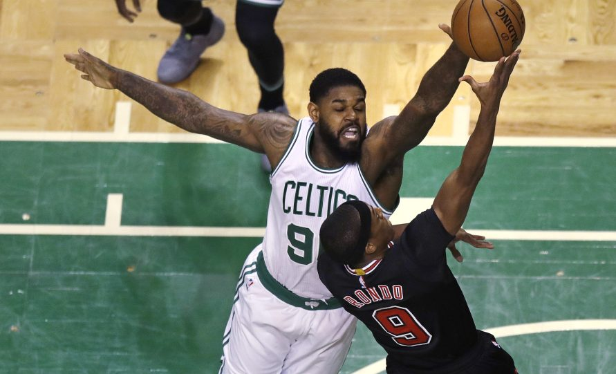 Boston Celtics forward Amir Johnson blocks a shot by Chicago Bulls guard Rajon Rondo during the first quarter in Boston on Tuesday.