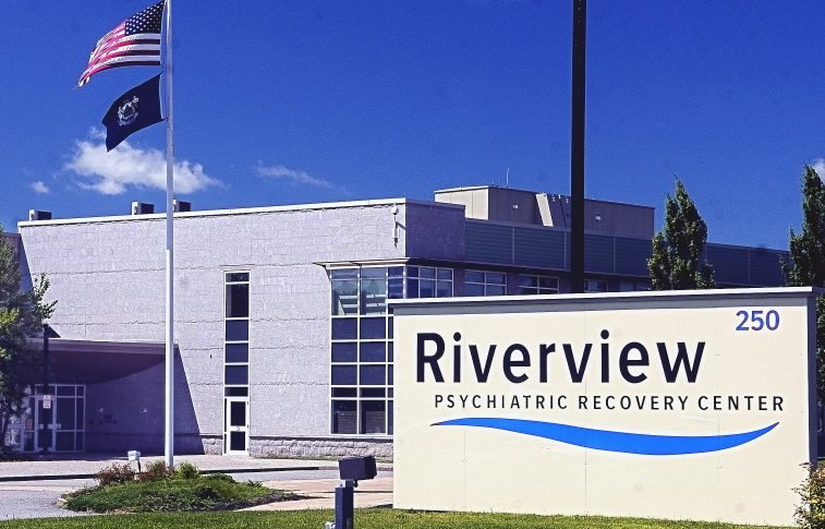 People are waiting eight to 12 days in ER hallways for a bed to open up at Riverview Psychiatric Center. A
