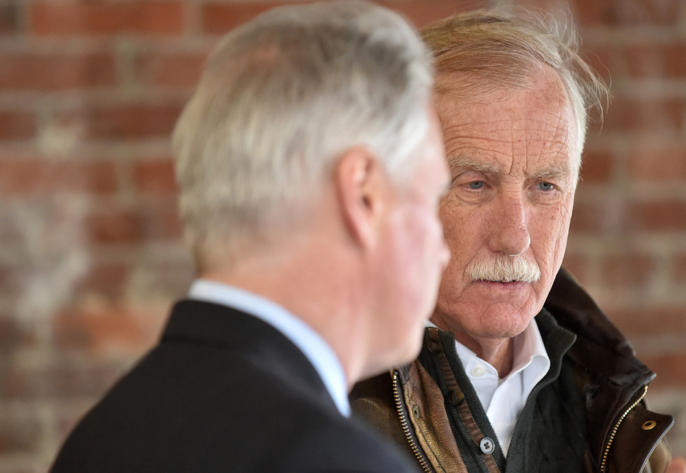 David Greene, president of Colby College, left, gives a tour Wednesday of the Haines Building on Main Street in downtown Waterville to U.S, Sen. Angus King.