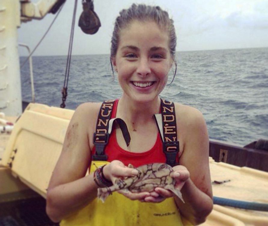 Hanna Sihler, an oceanography and biophysics major at the University of New England, holds a chain dogfish.