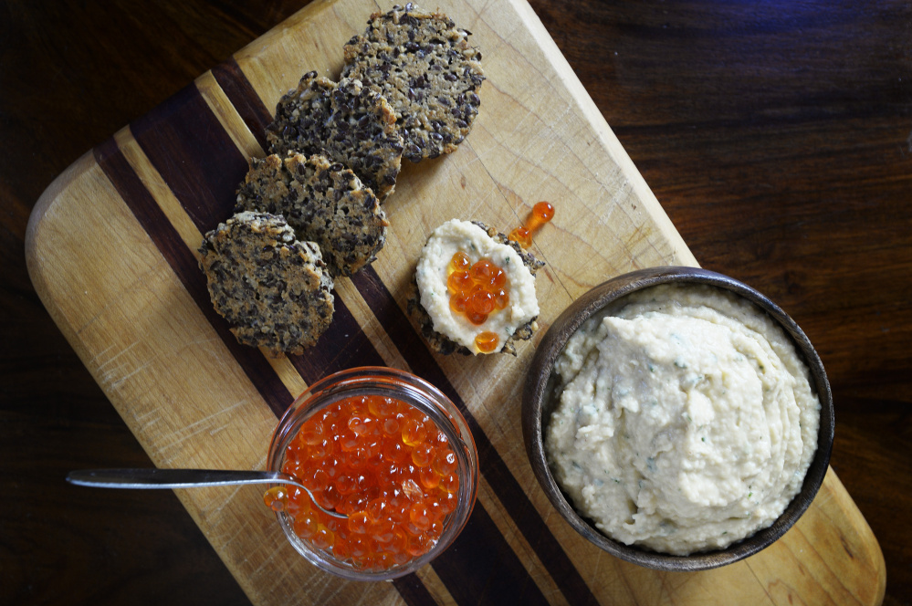 Sunflower-Flax Seed Frico with Navy Bean-Rosemary Hummus and fish eggs.