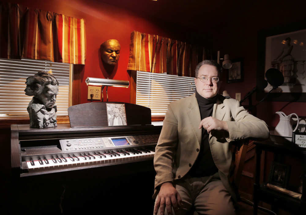 Composer Aaron Robinson in the studio of his home in Alna. Robinson's choral piece written in response to a terrorist attack uses Leonard Bernstein's words after the 1963 assassination of President John F. Kennedy.