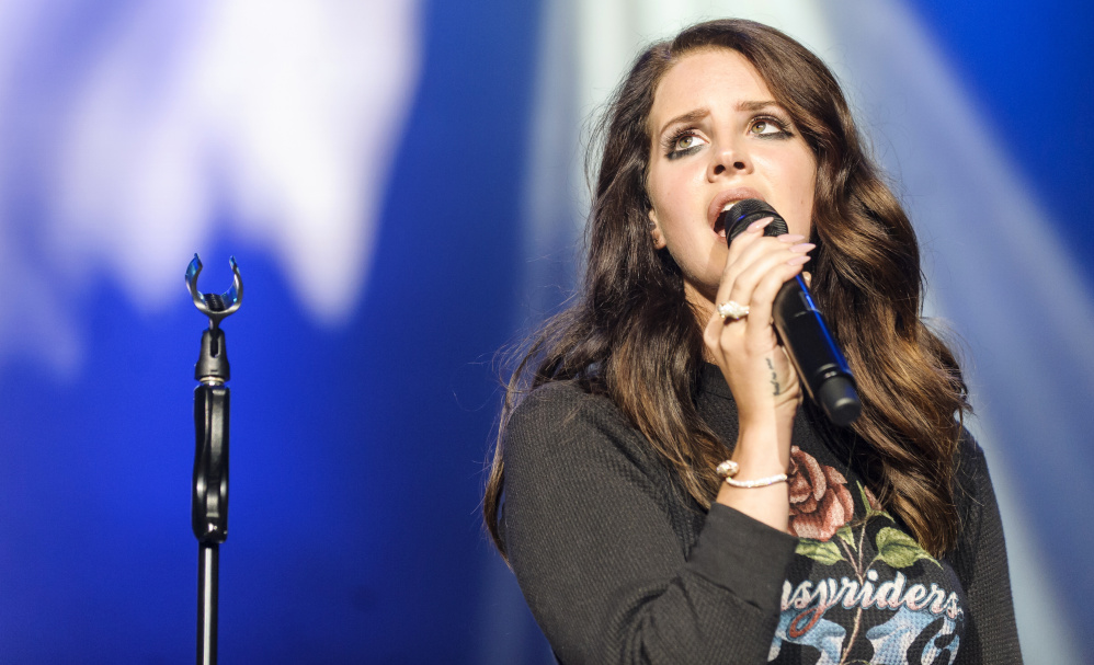 """Lana Del Rey performing in 2014. Her recent single """"Love"""" reflects a trend in American music known as pill-pop."""