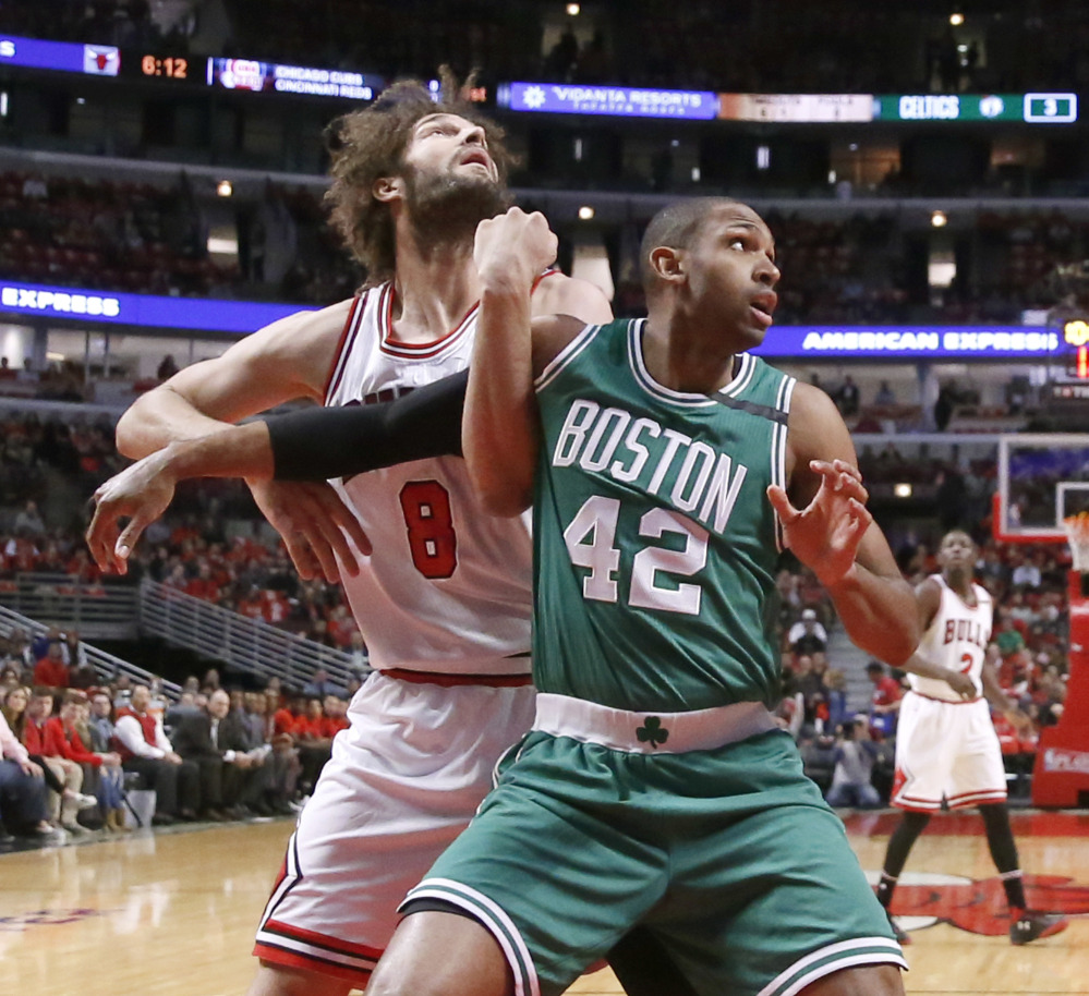 Chicago's Robin Lopez and Boston's Al Horford vie for position during the first half of Game 3 of their first-round playoff series in Chicago Friday night.