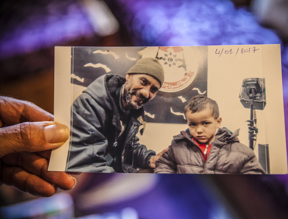 Faouzi Trabelsi shows a photo of himself with his grandson, Tamim Jaboudi, who has been trapped in a prison in Libya. Trabelsi has been unable to secure his grandson's release.