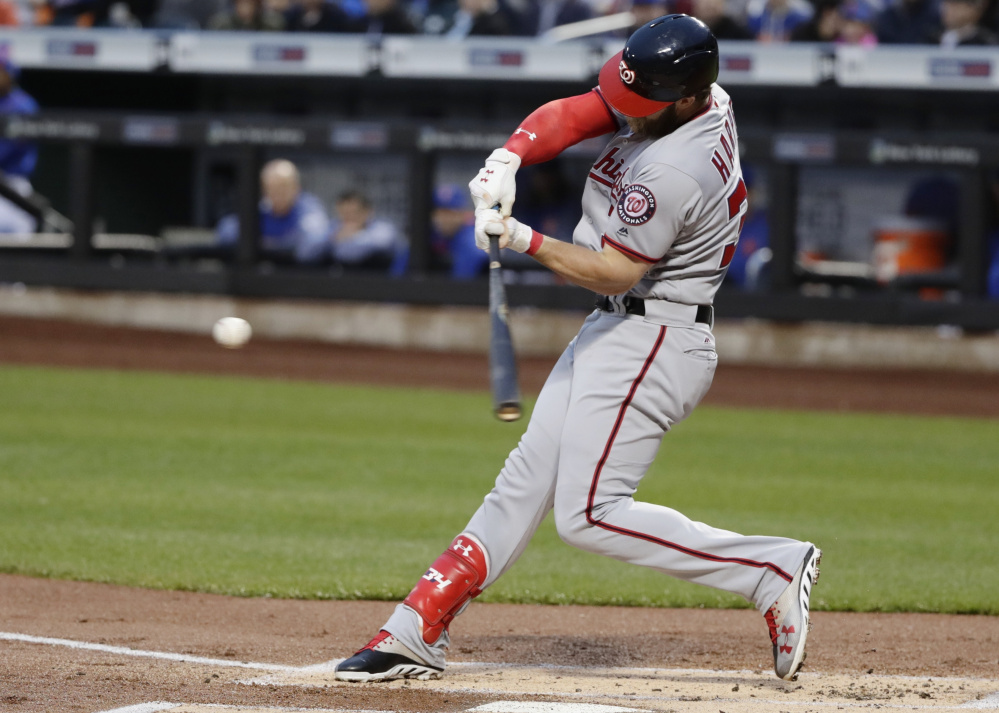 Bryce Harper of the Washington Nationals connects for a first-inning homer Friday night. The Nationals downed the New York Mets 4-3 in 11 innings for their fifth straight victory.