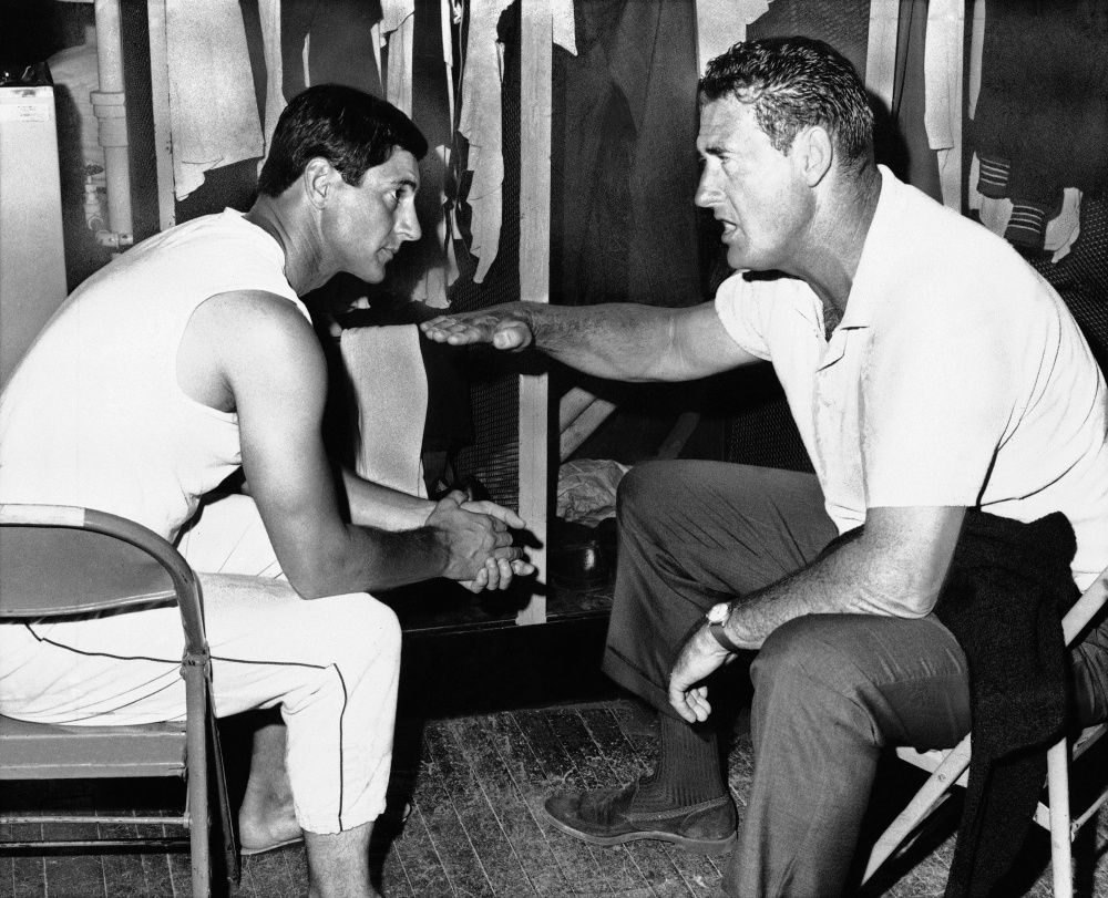 Ted Williams, who won two Triple Crowns with the Red Sox, gives some pregame advice to Carl Yastrzemski on the proper level to meet the ball on July 27, 1967. Yastrzemski hit a three-run double to highlight a six-run seventh inning that day in a win over California.