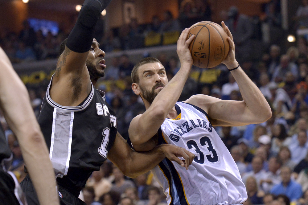 Grizzlies center Marc Gasol drives against San Antonio forward LaMarcus Aldridge during Game 4 of their first-round playoff series Saturday in Memphis, Tenn. Gasol's hit the winning basket with less than a second remaining in overtime as Memphis tied the series with a 110-108 win. (Associated Press/Brandon Dill)