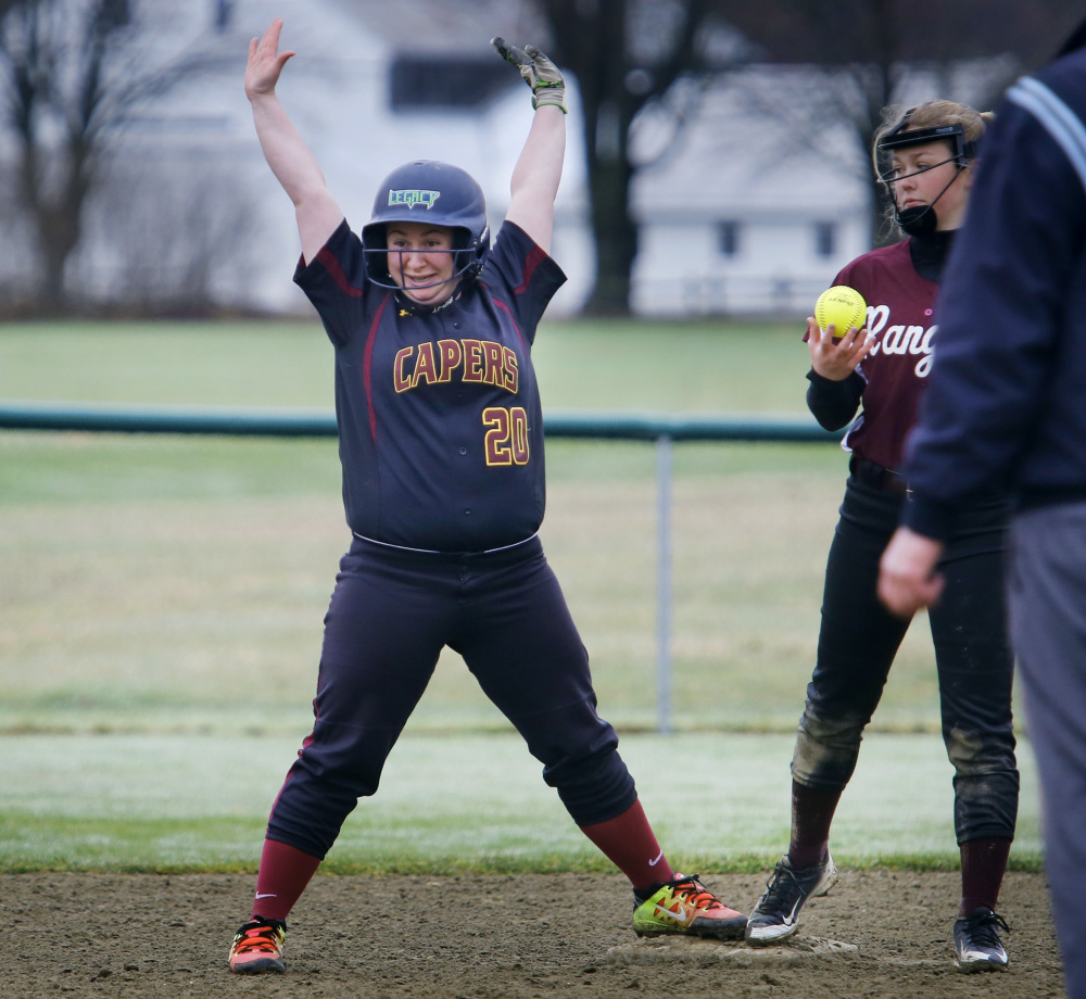 Elena Keller of Cape Elizabeth holds up at second after hitting a double in the sixth inning. The Capers collected 12 hits in their season-opening victory.