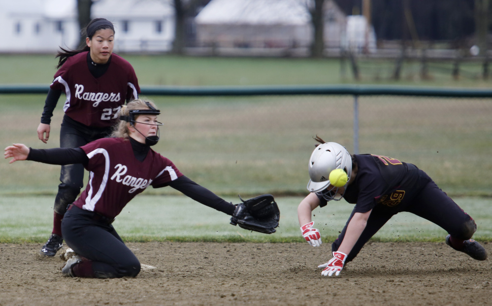 Hannah Johnston of Greely reaches for a throw as Katie LeDoux of Cape Elizabeth steals second base in the sixth inning Saturday. LeDoux had two RBI for the Capers in a 7-0 win.