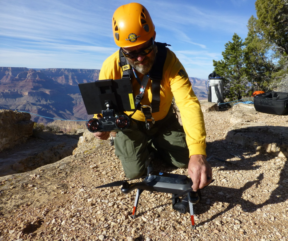 A Grand Canyon National Park employee operates a drone. The Grand Canyon is the only national park with its own fleet of unmanned aircraft for reaching people who have gotten lost, stranded, injured or killed. Under a program that began last fall, it has five drones and four certified operators. (Brandon Torres/Grand Canyon National Park via AP Photo)